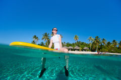 Young woman on paddle board Stock Photos