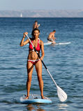 Young woman paddle boarding Royalty Free Stock Photos