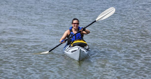Young woman paddling a kayak Royalty Free Stock Photo