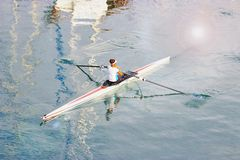 Young woman paddling a kayak. Sport, active lifestyle stock photos