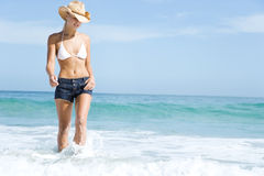 A young woman paddling in the sea Stock Images