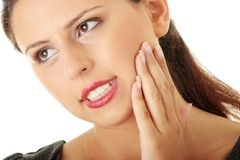 Young woman in pain Stock Images