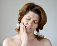 Young woman in pain is having   toothache Stock Photos