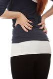Young woman with pain in her back. Royalty Free Stock Photo