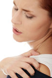 Young woman with pain in her back. Royalty Free Stock Image