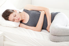 Young woman in pain Stock Photography
