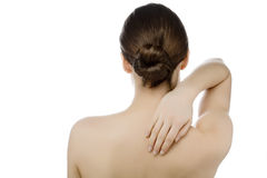 Young woman with pain in neck and back Stock Images