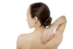 Young woman with pain in neck and back Stock Image