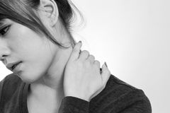 Young  woman with a pain in the neck Stock Images
