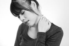 Young  woman with a pain in the neck Stock Photo