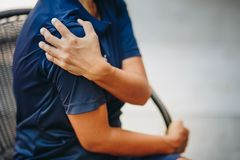 Young woman with pain in shoulder. Ache in human body , office syndrome , health care concept royalty free stock images