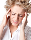Young woman with a painful headache Royalty Free Stock Photos