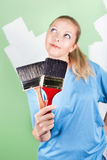 Young woman with paint brushes Stock Photos