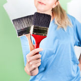 Young woman with paint brushes Royalty Free Stock Images
