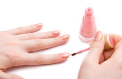 Young woman paint her nails Stock Photos
