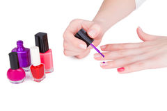 Young woman paint her nails Royalty Free Stock Images