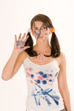 Young woman with paint on his face Stock Photography