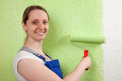 Young woman with paint roller Royalty Free Stock Photography