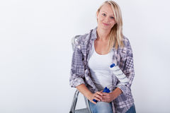 Young woman with paint roller Stock Image