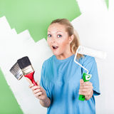 Young woman with paint tools Stock Images