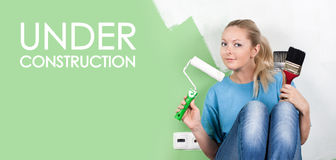 Young woman with paint tools. In hands stock photos