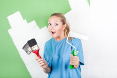 Young woman with paint tools royalty free stock images