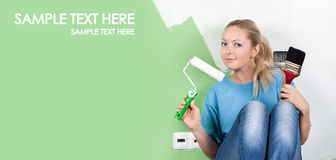 Young woman with paint tools. In hands royalty free stock photos