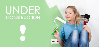 Young woman with paint tools. In hands stock photography