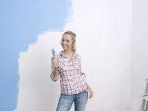 Young woman with paintbrush Royalty Free Stock Photos