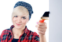Young woman with paintbrush Stock Photography