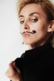 Young woman with painted mustache wearing jacket Stock Photo