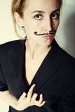 Young woman with painted mustache wearing jacket Royalty Free Stock Photos