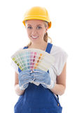 Young woman painter in blue builder uniform with colorful palett Stock Photo