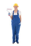 Young woman painter in blue builder uniform with paint brush iso Stock Photo