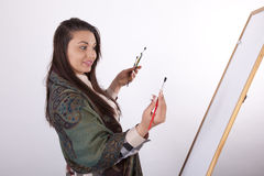 Young woman painting Stock Photography