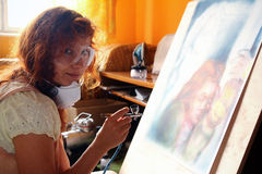 Young woman painting with airbrush equipment Royalty Free Stock Photo