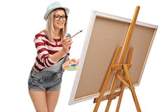 Young woman painting on a canvas Stock Photo