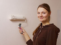 Young woman painting her home wall. Handmade Royalty Free Stock Photo