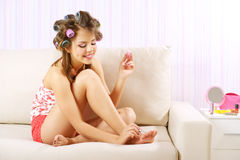 Young woman painting her nails Stock Photography