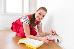 Young woman painting her new apartment Stock Image