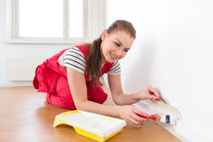 Young woman painting her new apartment Stock Photography
