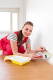 Young woman painting her new apartment Stock Images