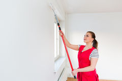 Young woman painting her new apartment Royalty Free Stock Photo