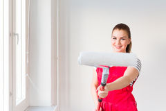 Young woman painting her new apartment Stock Photos