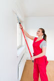 Young woman painting her new apartment Royalty Free Stock Images