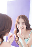 Young woman painting  lip balm Stock Photography