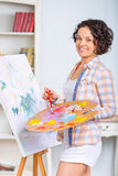 Young woman is painting a picture Stock Image