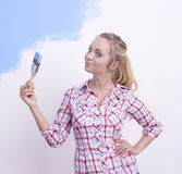 Young woman painting wall Royalty Free Stock Image