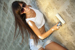 Young woman painting the wall stock photo
