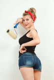 Young woman painting wall Stock Photo